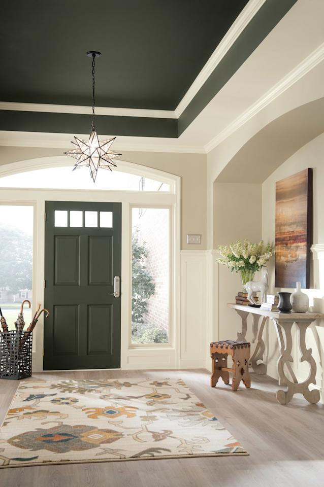 "<p>Picking the right <a href=""https://www.realsimple.com/home-organizing/home-improvement/painting/clean-interior-paint-colors"">paint colors</a> won't contribute to the organization of your entryway, but it could distract visitors enough that they don't notice any lingering clutter in the foyer. Plus, walking into a color-coordinated space like this entryway, with its matching door and ceiling painted olive green (similar to <a href=""https://www.sherwin-williams.com/homeowners/color/find-and-explore-colors/paint-colors-by-family/SW6195-rock-garden#/6195/?s=coordinatingColors&p=PS0"">Rock Garden by Sherwin-Williams</a>), is sure to soothe the soul.</p>"