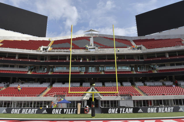 Workers continue to put the final touches on the expansion of Cardinal Stadium, Wednesday, Sept. 5, 2018, in Louisville, Ky. The expansion adds about 6,000 seats to Cardinal Stadium, including expensive and exclusive field-level suites, premium boxes and club seats, among other amenities. Louisville plays Indiana State this week. (AP Photo/Timothy D. Easley)