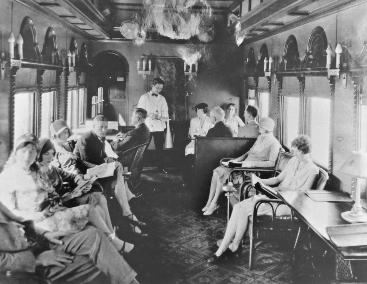 This undated photo provided by the Monroe County Library shows passengers riding in the club car of Henry Flagler's Florida Keys Over-Sea Railroad train. The centennial anniversary of the first train's arrival into Key West and the completion of the Over-Sea Railroad project will be marked on Jan. 22, 2012. (AP Photo/Monroe County Library via the Florida Keys News Bureau)
