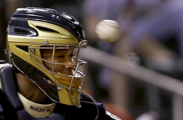 Milwaukee Brewers catcher Martin Maldonado takes a foul ball off his face mask during the seventh inning of a baseball game against the St. Louis Cardinals on Tuesday, Sept. 10, 2013, in St. Louis. (AP Photo/Jeff Roberson)