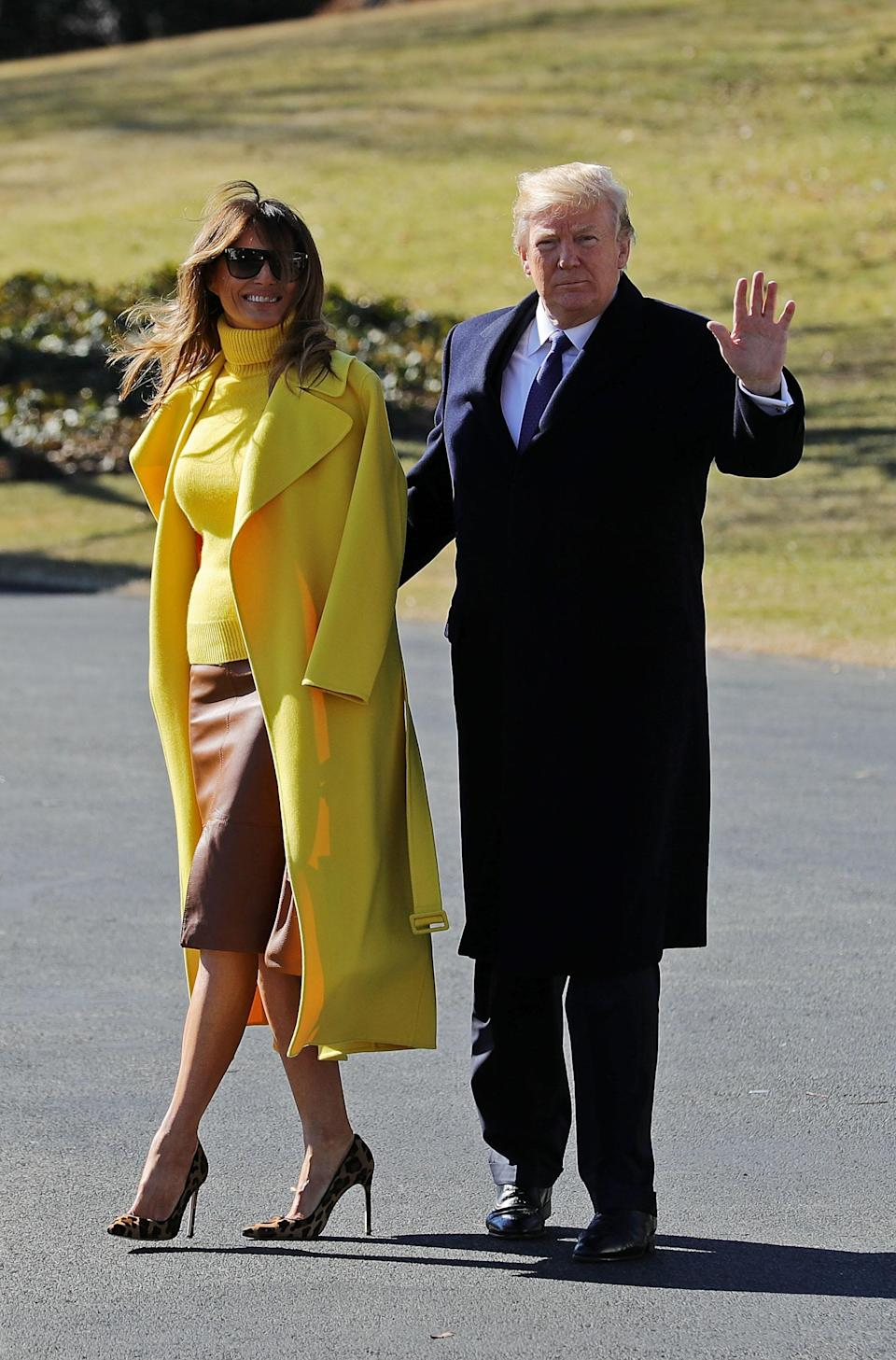 For a trip to Ohio with Donald Trump, Melania dressed in canary yellow. The coat draped over her shoulders is courtesy of Ralph Lauren which she teamed with a leather skirt by Hervé Pierre. [Photo: Getty]