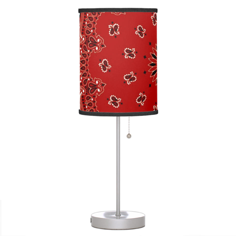 This image released by Zazzle shows a lamp with a shade that features a bandana paisley motif. The lamp also comes in blue, purple, turquoise, green or gold. (Zazzle via AP)