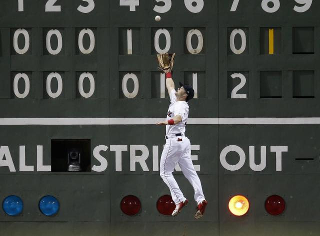 Boston Red Sox's Andrew Benintendi makes the catch on a fly-out by Los Angeles Angels' David Fletcher during the eighth inning of a baseball game in Boston, Thursday, June 28, 2018. (AP Photo/Michael Dwyer)