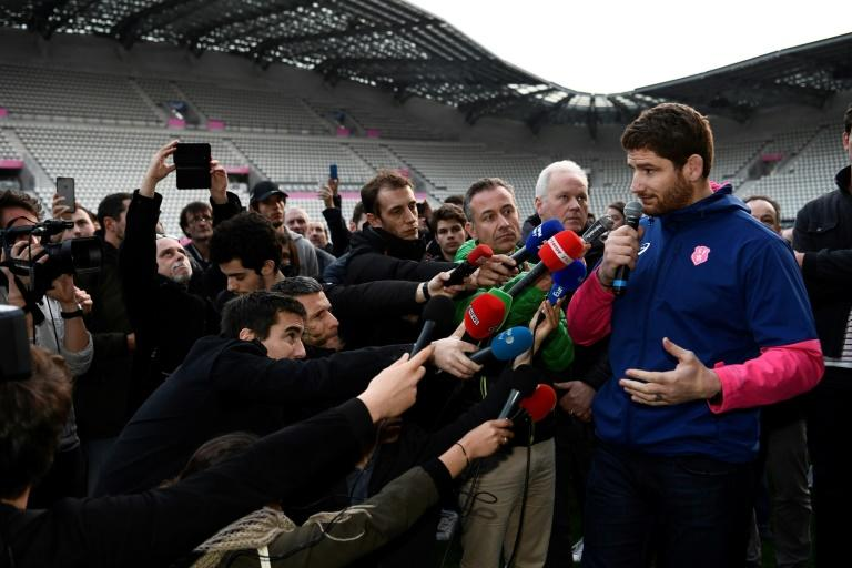 Stade Francais Paris' French lock Pascal Pape (R) speaks to journalists on March 13, 2017 at the Stade Jean Bouin in Paris