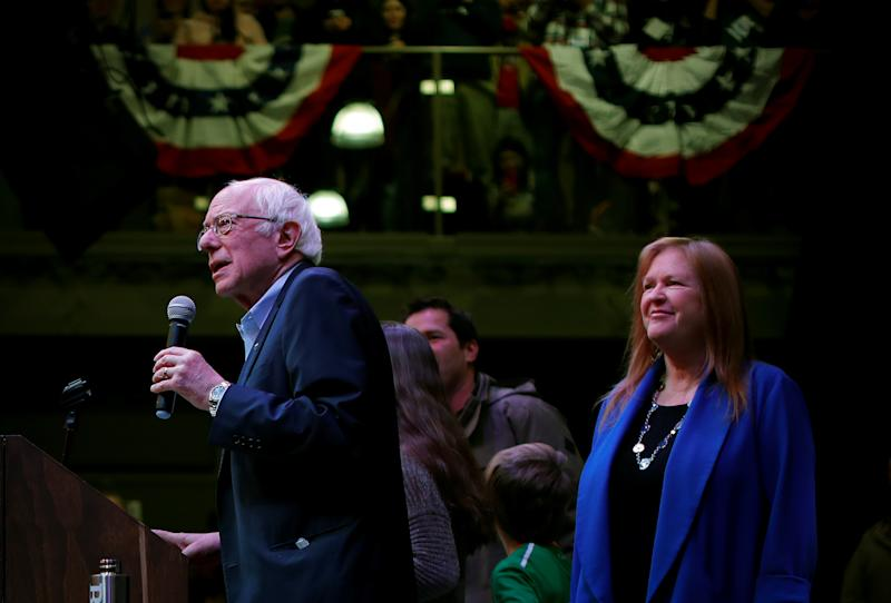 Sen. Bernie Sanders addresses a college town hall campaign as his wife, Jane, looks on