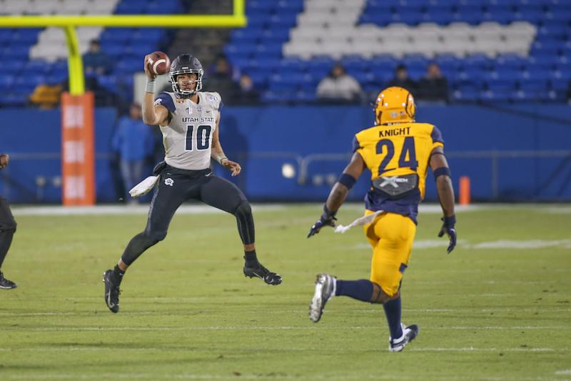 Utah State Aggies QB Jordan Love (10) rolls out to pass during the Frisco Bowl on Dec.20, 2019. (George Walker/Icon Sportswire via Getty Images)