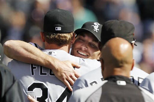 Chicago White Sox starting pitcher Philip Humber, center, is mobbed by teammates after pitching a perfect baseball game against the Seattle Mariners, Saturday, April 21, 2012, in Seattle. The White Sox won 4-0. (AP Photo/Elaine Thompson)