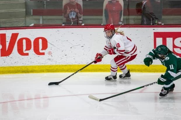 Kentville's Brette Pettet (20) is shown in action from earlier this season. Pettet captained the Wisconsin Badgers to the NCAA championship with a 2-1 win in overtime over the Northeastern Huskies on Saturday. (University of Wisconsin - image credit)