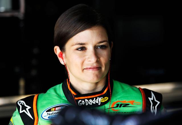 HOMESTEAD, FL - NOVEMBER 16: Danica Patrick, driver of the #7 GoDaddy.com Chevrolet, stands in the garage during practice for the NASCAR Nationwide Series Ford EcoBoost 300 at Homestead-Miami Speedway on November 16, 2012 in Homestead, Florida. (Photo by Tom Pennington/Getty Images)