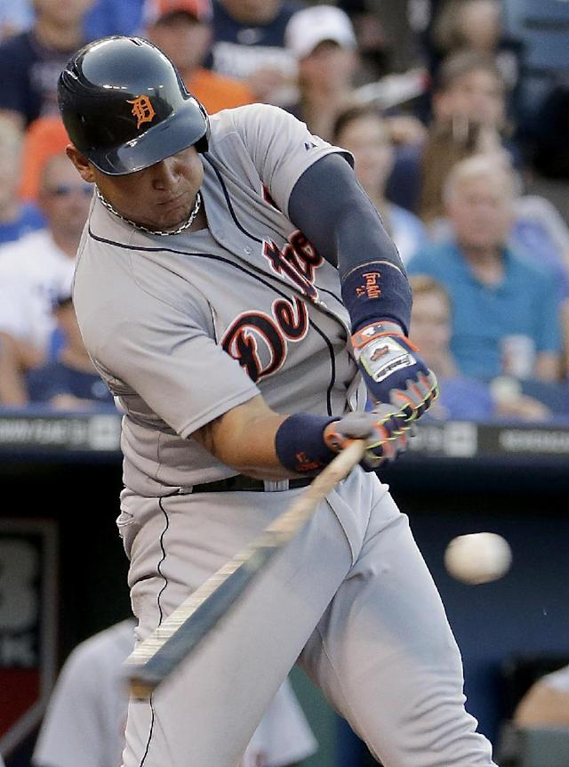 Detroit Tigers' Miguel Cabrera hits a sacrifice fly to score Rajai Davis during the third inning of a baseball game against the Kansas City Royals on Friday, July 11, 2014, in Kansas City, Mo. (AP Photo/Charlie Riedel)