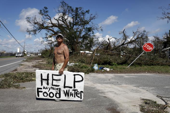 """<p>Michael Williams, 70, looks for help from passing motorists for food and water as downed trees prevent him from driving out of his damaged home in the aftermath of hurricane Michael with his family in Springfield, Fla., Thursday, Oct. 11, 2018. """"I don't know what I'm going to do,"""" said Williams. (Photo: David Goldman/AP) </p>"""