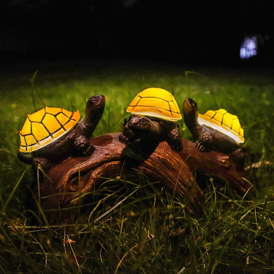 <p>The <span>pearlstar Solar Outdoor Statues Turtle on Log Yard Decor, Waterproof</span> ($30) is such an adorable find that will add character to your backyard.</p>