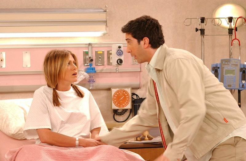 Actors Jennifer Aniston (L) and David Schwimmer are shown in a scene from the NBC series 'Friends'. The series received 11 Emmy nominations, including outstanding comedy series, by the Academy of Television Arts and Sciences July 18, 2002 in Los Angeles, California. (Photo by Warner Bros. Television/Getty Images)
