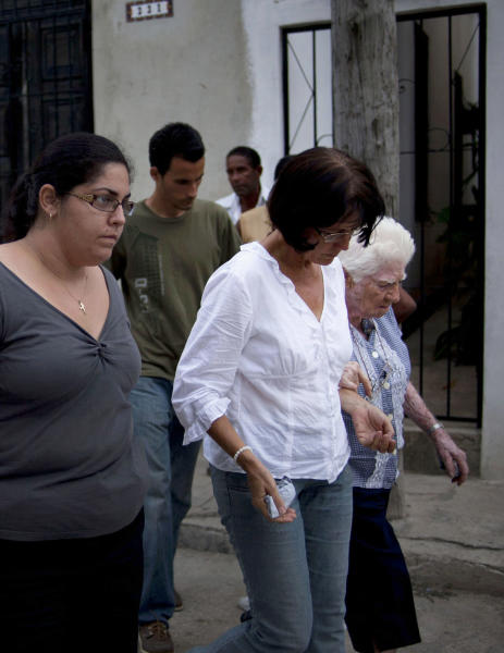 Relatives of the Cuban dissident Oswaldo Paya leave his house in Havana, Cuba, Sunday, July 22, 2012. Paya died in a car crash. He was 60 years old. Dissident Elizardo Sanchez says he confirmed Paya's death on Sunday with associates in the city of Bayamo, 500 miles (800 kilometers) east of the capital. (AP Photo/Ramon Espinosa)