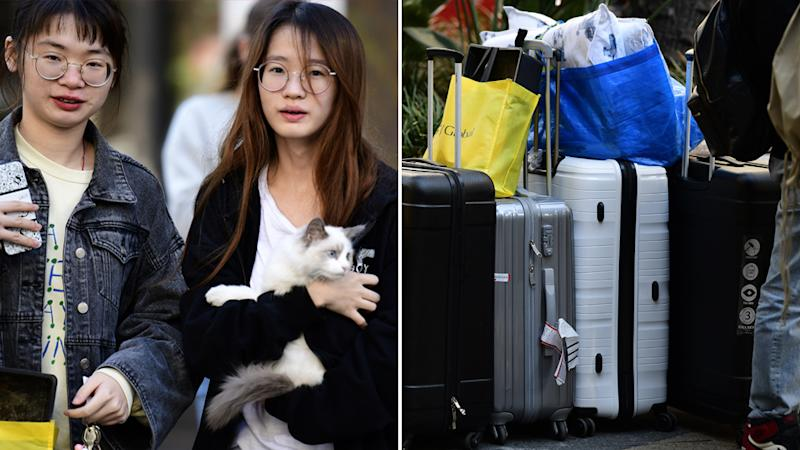 Residents leaving the Sydney apartment block carrying their belongings and pets.