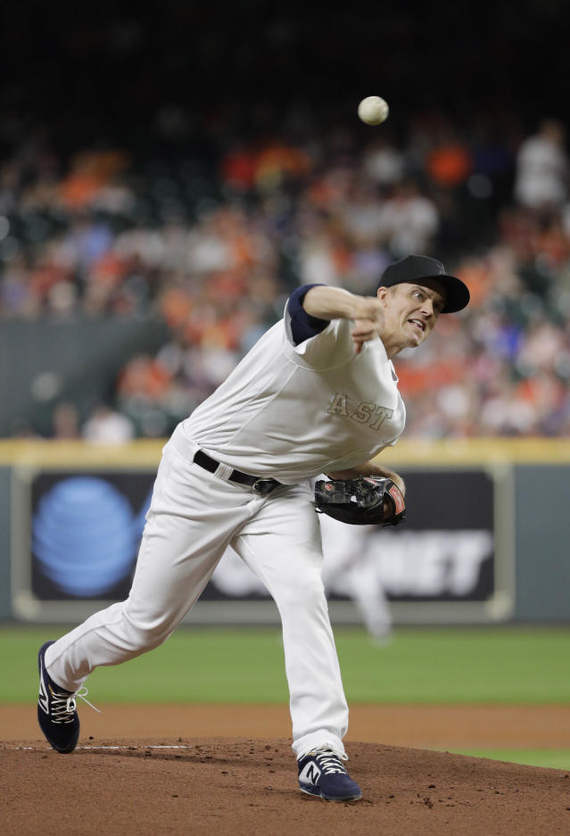 Houston Astros starting pitcher Zack Greinke throws against the Los Angeles Angels during the first inning of a baseball game Friday, Aug. 23, 2019, in Houston. (AP Photo/David J. Phillip)