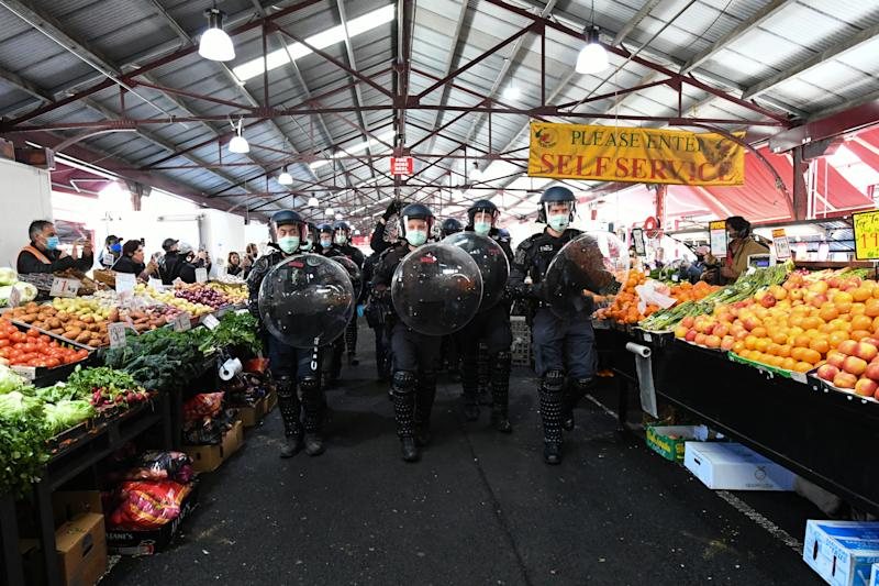 Picture of Victoria Police marching through the Queen Victoria Markets during a Freedom Rally in Melbourne