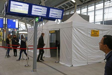 People cast their vote for the consultative referendum on the association between Ukraine and the European Union in a makeshift polling booth at the Central train station in Utrecht