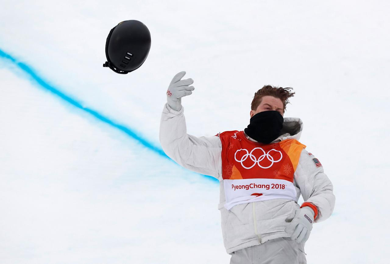 <p>American snowboarder Shaun White had a massive 94.25 opening run to open the halfpipe finals. After his run, he threw his helmet into the crowd to celebrate. REUTERS/Issei Kato TPX IMAGES OF THE DAY </p>