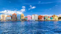 <p>Upon reaching the shore of the Caribbean island, guests are greeted with pastel-colored Dutch Colonial-style buildings lining the bay. The bustling streets and alleys of Willemstad blend together old European charm with Caribbean flair, creating an atmosphere found nowhere else on this planet.</p>