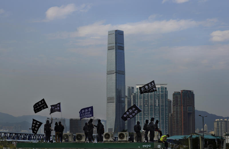 """Protesters wave flags that read """"Hong Kong Independence"""" during a rally in Hong Kong, Sunday, Jan. 12, 2020. More than a thousand people attended a Sunday rally in Hong Kong to urge people and governments abroad to support the territory's pro-democracy movement and oppose China's ruling Communist Party. (AP Photo/Vincent Yu)"""