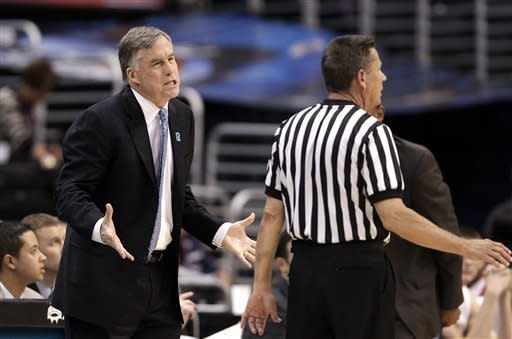 California head coach Mike Montgomery, left, talks to a referee during the first half of an NCAA college basketball game against Stanford at the Pac-12 conference championship in Los Angeles, Thursday, March 8, 2012. (AP Photo/Jae C. Hong)