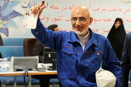 Mostafa Mirsalim, Iranian former minister of culture, holds his document as he registers his candidacy for presidential elections at the Interior Ministry in central Tehran