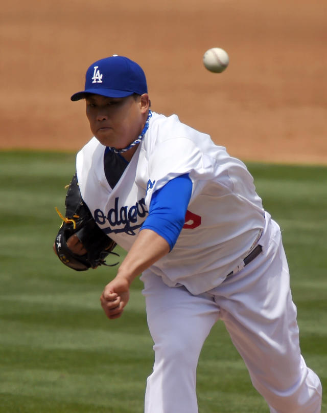 Los Angeles Dodgers starting pitcher Ryu Hyun-Jin, of South Korea, throws to the plate during the second inning of a baseball game against the Colorado Rockies, Sunday, April 27, 2014, in Los Angeles. (AP Photo/Mark J. Terrill)