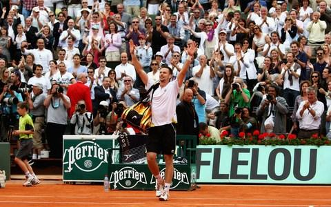 Robin Soderling of Sweden salutes the fans following his victory during the Men's Singles Fourth Round match against reigning champion Rafael Nadal of Spain on day eight of the French Open at Roland Garros on May 31, 2009 in Paris, France - Credit: Getty Images