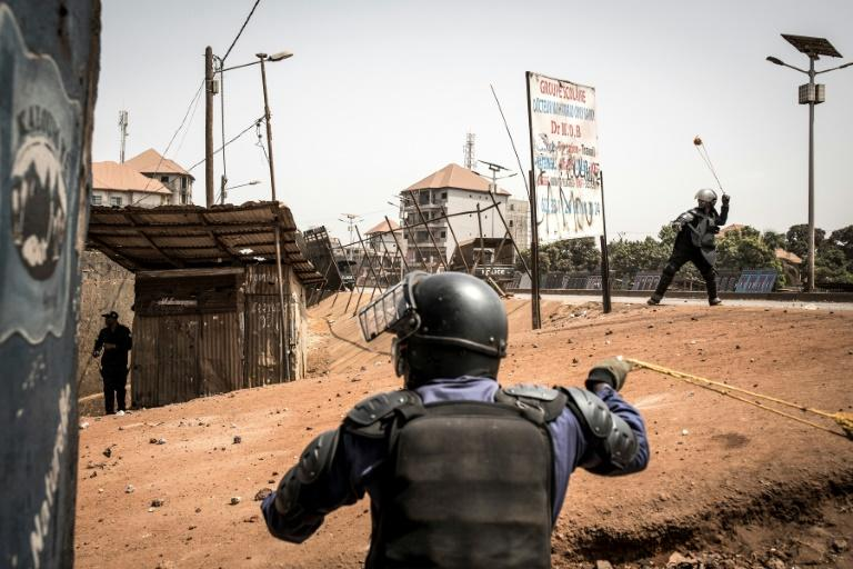 Policemen fired slingshots as an anti-Conde demonstration in Conakry last month turned violent
