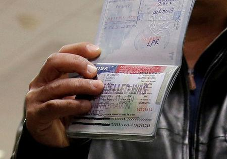 FILE PHOTO: A member of the Al Murisi family, Yemeni nationals who were denied entry into the U.S. last week because of the recent travel ban, show the cancelled visa in their passport at Washington Dulles International Airport in Chantilly