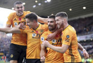 Wolverhampton Wanderers' Ruben Neves, center, celebrates scoring his side's first goal of the game with teammates during their English Premier League soccer match against Aston Villa at Molineux, Wolverhampton, England, Sunday, Nov. 10, 2019. (Nick Potts/PA via AP)