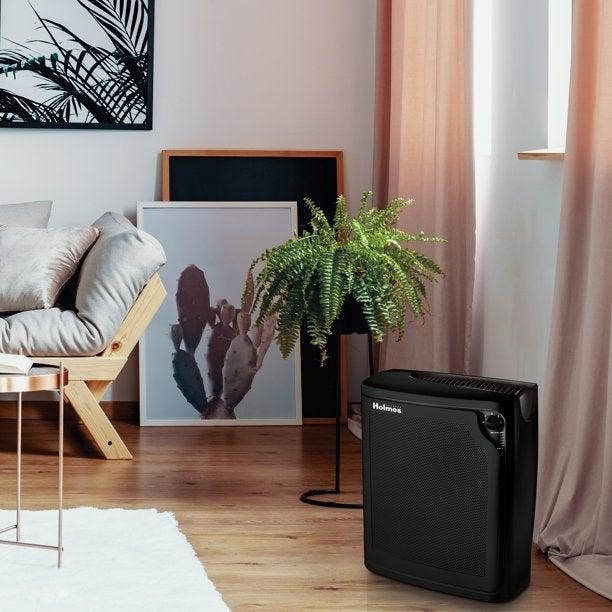 """<h3><a href=""""https://www.walmart.com/ip/Holmes-Allergen-Removing-Air-Purifier-with-True-HEPA-Filter-Black/22351038"""" rel=""""nofollow noopener"""" target=""""_blank"""" data-ylk=""""slk:Holmes Allergen Removing Air Purifier with True HEPA Filter"""" class=""""link rapid-noclick-resp"""">Holmes Allergen Removing Air Purifier with True HEPA Filter</a></h3><br>While you'll hardly even notice this quietly operating unit, that certainly doesn't mean it's not hard at work filtering household dust, pollen, dust mites, and more. It features 99.97 percent filtration and mold capturing technology to help keep your environment as healthy as possible. <br><br><strong>Holmes</strong> Allergen Removing Air Purifier with True HEPA Filter, $, available at <a href=""""https://go.skimresources.com/?id=30283X879131&url=https%3A%2F%2Fwww.walmart.com%2Fip%2FHolmes-Allergen-Removing-Air-Purifier-with-True-HEPA-Filter-Black%2F22351038"""" rel=""""nofollow noopener"""" target=""""_blank"""" data-ylk=""""slk:Walmart"""" class=""""link rapid-noclick-resp"""">Walmart</a>"""