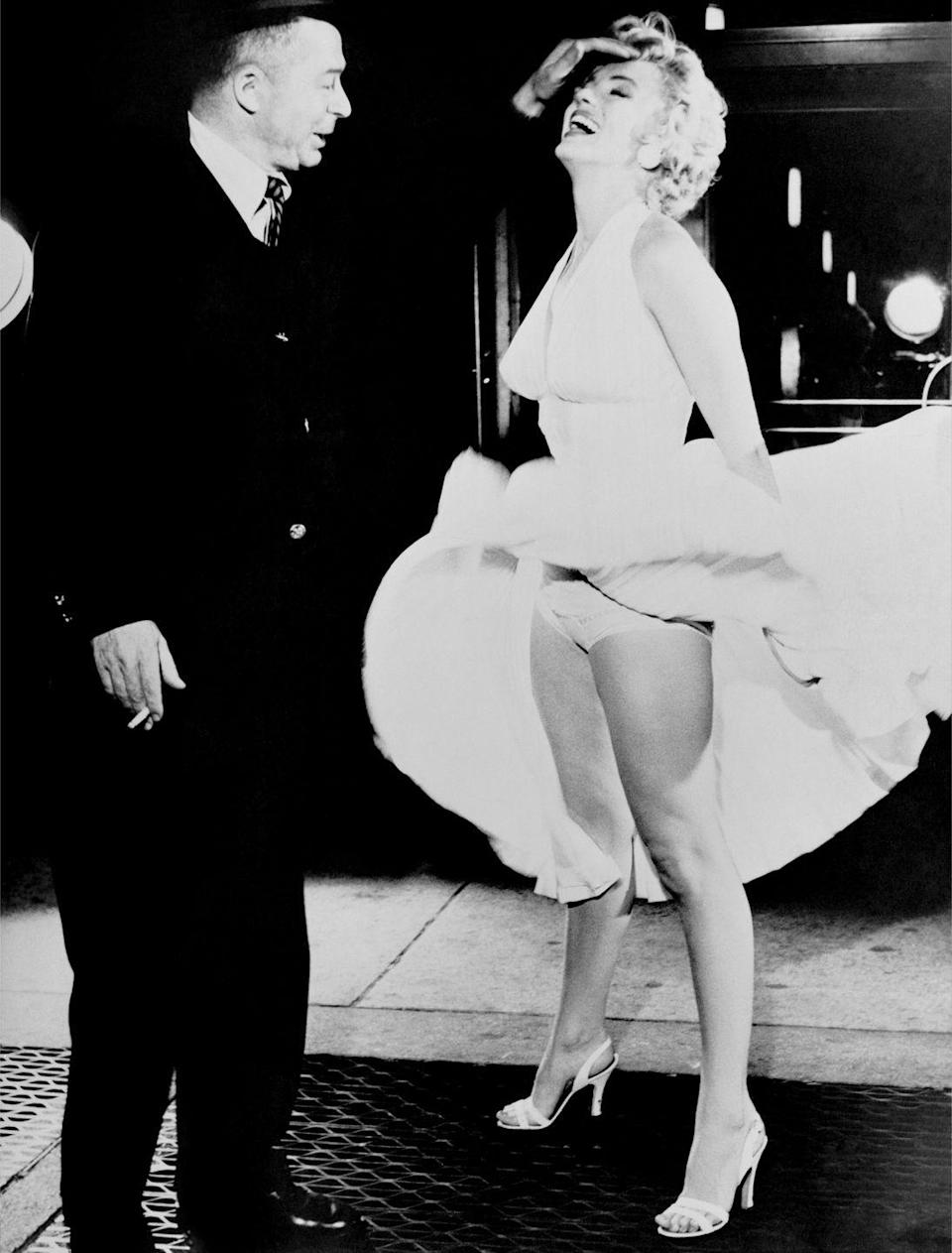 <p>Director Billy Wilder orchestrates the infamous air vent photo with actress Marilyn Monroe during a press shoot for their movie, <em>The Seven Year Itch</em>. </p>
