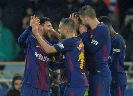 Soccer Football - La Liga Santander - Real Sociedad vs FC Barcelona - Anoeta Stadium, San Sebastian, Spain - January 14, 2018 Barcelona's Lionel Messi celebrates with team mates after scoring their fourth goal REUTERS/Vincent West