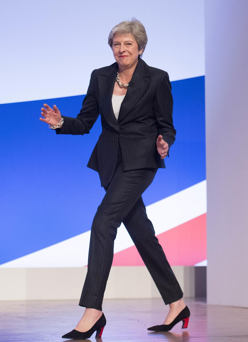 "Her Conservative Party annual conference entrance became infamous when she strutted onto stage with ABBA's ""Dancing Queen"" playing in the background. Photo dated 03/10/18 (PA)"