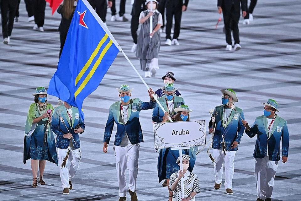 <p>Aruba's delegation brought bright colors to the opening ceremony, donning green and teal ensembles and matching hats. </p>