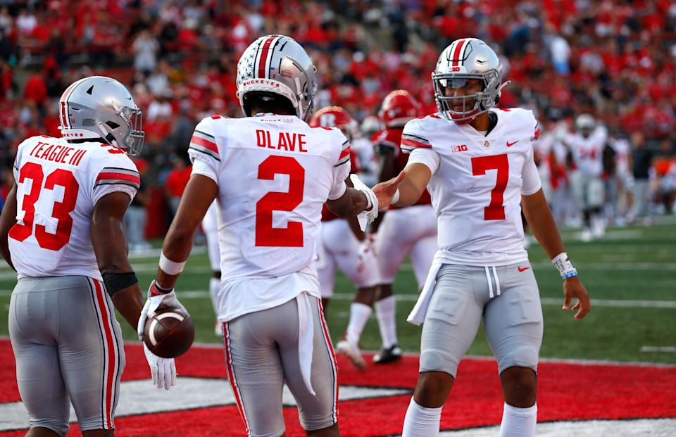 Ohio State quarterback C.J. Stroud (7) shakes hands with wide receiver Chris Olave (2) after Olave's touchdown reception against Rutgers.