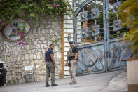 FBI agents assisting the investigation of the assassination of President Jovenel Moise stand outside his residence in Port-au-Prince, Haiti, Thursday, July 15, 2021. President Moise was assassinated in the residence on July 7. (AP Photo/Joseph Odelyn)