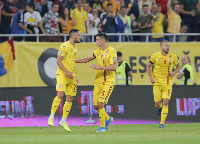 Romania's Florin Andone, left celebrates after scoring his side's first goal during the Euro 2020 group F qualifying soccer match between Romania and Spain, at the National Arena stadium in Bucharest, Romania, Thursday, Sept. 5, 2019. (AP Photo/Vadim Ghirda)