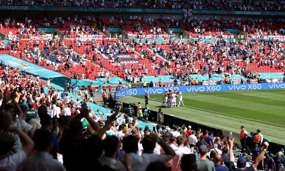 Raheem Sterling and teammates celebrate after England's winner.