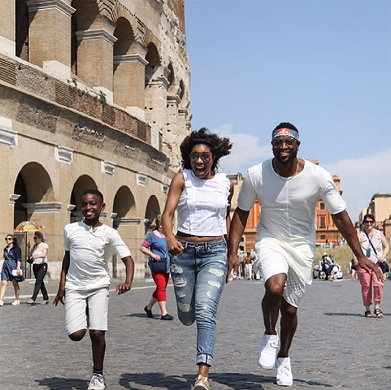 "<p>They are accompanied on their vacay by Wade's son Zion. The boy had no problem keeping up in the style department, as you can see here as he twins with his dad. ""Living our life & we're not apologizing for it,"" Wade captioned this photo. (Photo: <a rel=""nofollow"" href=""https://www.instagram.com/p/BVfv0oCgF3-/?hl=en"">Dwyane Wade via Instagram</a>) </p>"