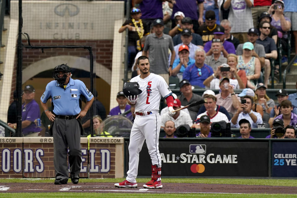 National League's Nolan Arenado, of the St. Louis Cardinals, acknowledges the crowd during the first inning of the MLB All-Star baseball game, Tuesday, July 13, 2021, in Denver. (AP Photo/Gabriel Christus)