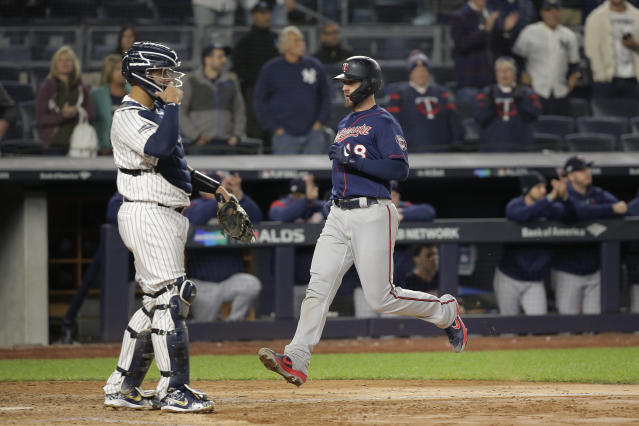 Minnesota Twins catcher Mitch Garver (18) scores a run against the New York Yankees during the ninth inning of Game 2 of an American League Division Series baseball game, Saturday, Oct. 5, 2019, in New York. (AP Photo/Seth Wenig)