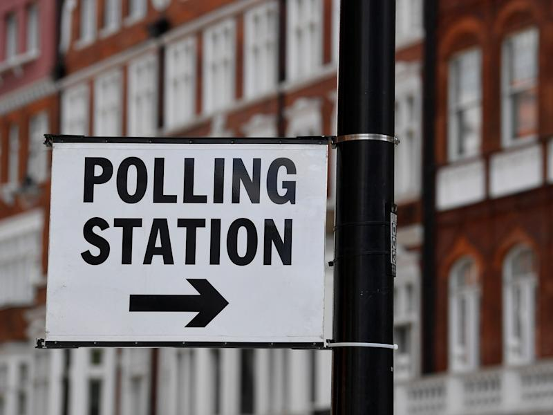 A polling station direction sign is seen placed on a lamppost, ahead of the forthcoming EU elections, in London: Reuters