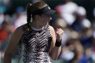 Jelena Ostapenko, of Latvia, celebrates after winning a game against Iga Swiatek, of Poland, at the BNP Paribas Open tennis tournament Tuesday, Oct. 12, 2021, in Indian Wells, Calif. (AP Photo/Mark J. Terrill)