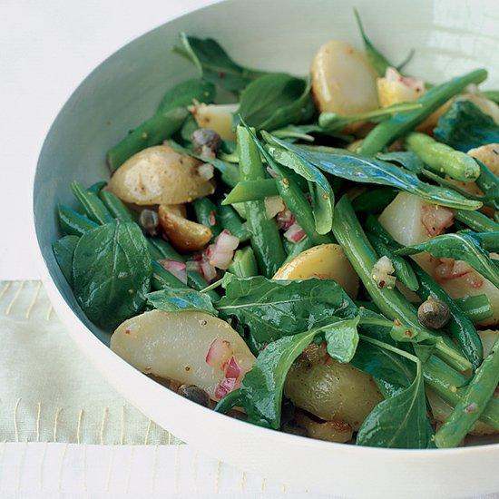 """<p>Use fingerling, Yellow Finn or Yukon Gold potatoes in this salad and toss them gently with the vinaigrette so they keep their shape.</p><p><a href=""""https://www.foodandwine.com/recipes/arugula-salad-potatoes-and-green-beans"""">GO TO RECIPE</a></p>"""