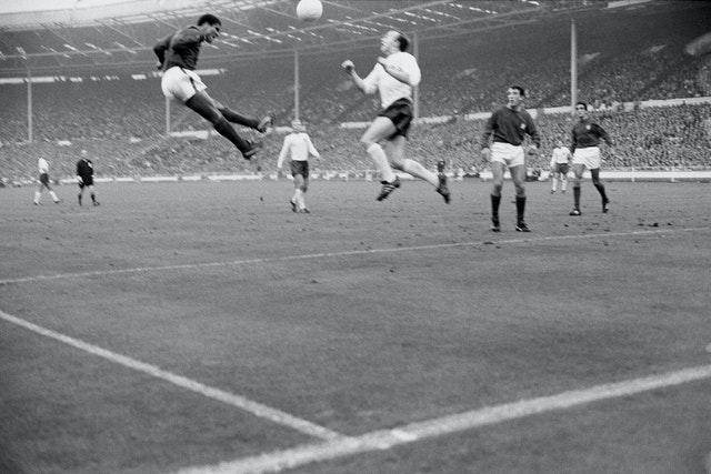 Portugal's Eusebio jumps for the ball with England's Stiles during the World Cup semi-final at Wembley, which England won 2-1