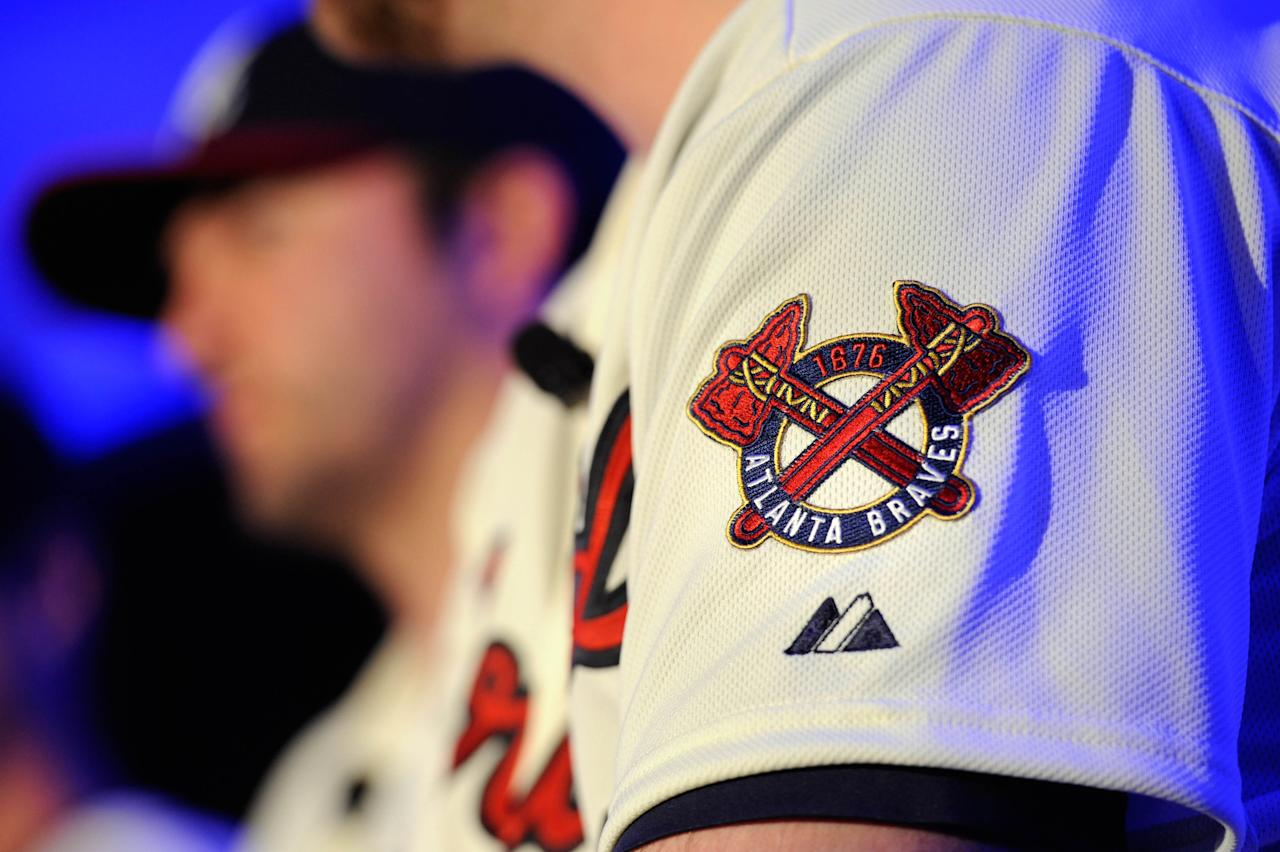 Atlanta Braves' Brian McCann wears the club's new alternative home uniform during a news conference to introduce the threads, Monday, Feb. 6 , 2012, in Atlanta. The uniform pays homage to the team's past, reflecting more of the look of the 1966 team, which also featured a patch on the sleeve. (AP Photo/John Amis)
