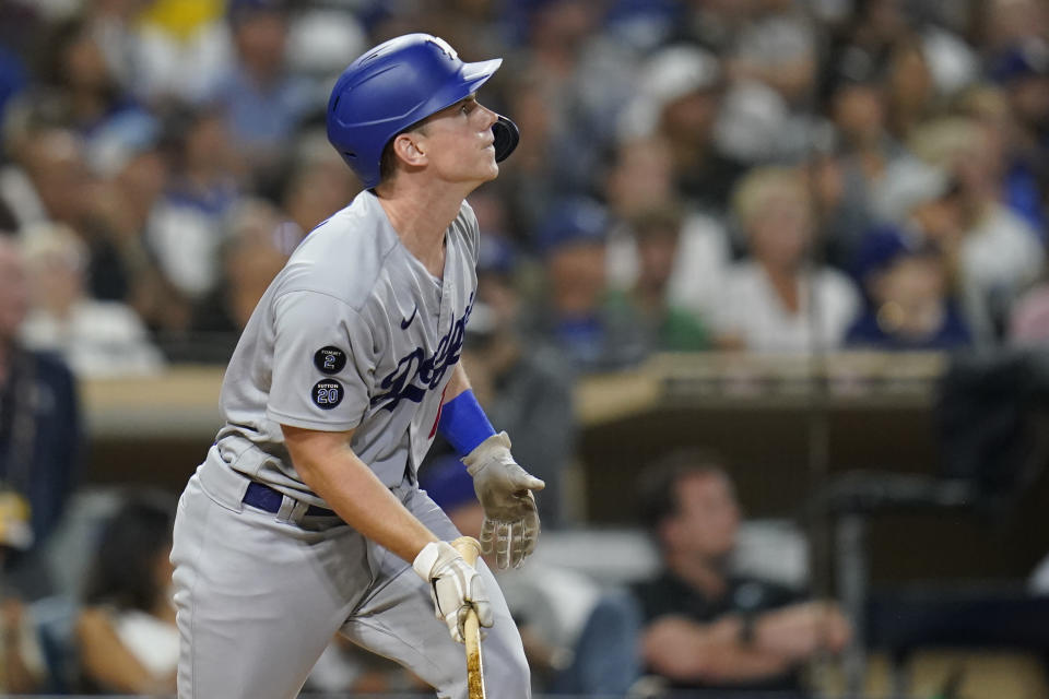 Los Angeles Dodgers' Will Smith watches his home run during the eighth inning of the team's baseball game against the San Diego Padres, Wednesday, Aug. 25, 2021, in San Diego. (AP Photo/Gregory Bull)